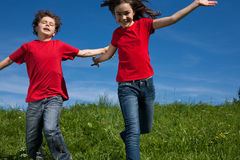 Kids running outdoor Stock Photos