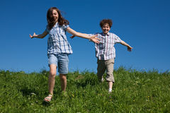 Kids running outdoor Royalty Free Stock Photo