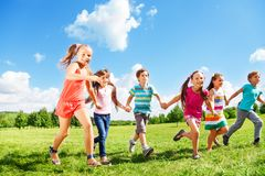 Kids running in the park Royalty Free Stock Photos