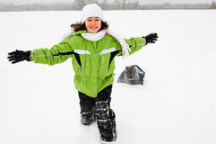 Kids running on snowy field Stock Images