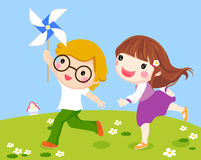 Kids Running Together Outside With Windmill Stock Photography