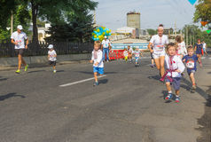 Kids running in Vyshyvanka Run. Dnepr, Ukraine - August 24, 2016: Kids running in Vyshyvanka Run during Independence Day local activity in Dnepr, Ukraine at Royalty Free Stock Image