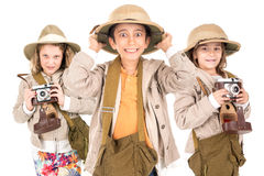 Kids in safari clothes. Group of kids having fun with cameras in safari clothes stock photo
