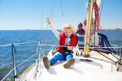 Kids sail on yacht in sea. Child sailing on boat royalty free stock images