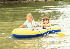 Kids sailing in punt. Little kids - girl and boy sailing in the gummy punt Stock Photography