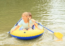 Kids sailing in punt. Little kids - girl and boy sailing in the gummy punt Stock Image