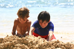 Kids in the sand. Kids playind in the sand at the beach Stock Image