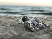 Father Kids sand beach slippers on the beach. Kids sand beach slippers on the beach father stock photography