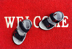 Kids sandals. On the red carpet with words Royalty Free Stock Photos
