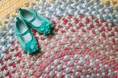 Kids' sandals on the handmade colorful rug Royalty Free Stock Images