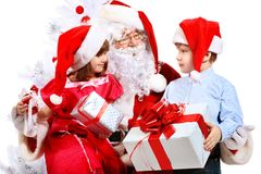 Kids with santa. Christmas theme: Santa Claus and children having a fun. Isolated over white background Stock Photo
