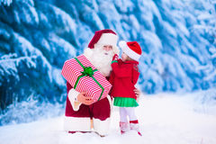 Kids and Santa with Christmas presents Stock Images