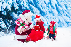 Kids and Santa with Christmas presents Royalty Free Stock Photos