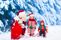 Kids and Santa with Christmas presents Royalty Free Stock Image