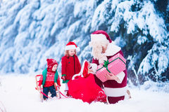 Kids and Santa with Christmas presents Royalty Free Stock Images