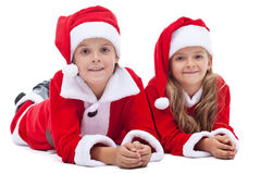 Kids in santa costumes at christmas time Royalty Free Stock Photography