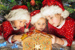 Kids in Santa hats have a Christmas Royalty Free Stock Images