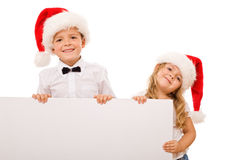 Kids with santa hats and white banner for text stock images