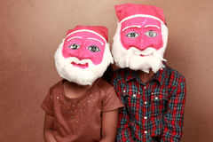 Kids with santa masks Royalty Free Stock Photography