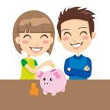 Kids Saving Money. Little boy and girl happy saving money in pink piggy bank Stock Photography