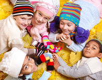 Kids in scarves and hats. Cheerful kids in scarves and hats Stock Image