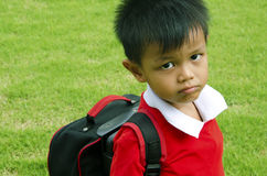 Kids school bag. With grass in the background Stock Photo