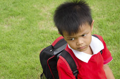 Kids school bag. With grass in the background Royalty Free Stock Photo