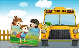 Kids and school bus Stock Photography