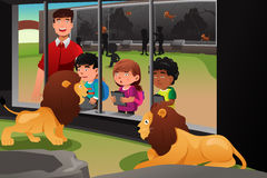 Kids school field trip to the zoo. A vector illustration of kids on a school field trip to the zoo Royalty Free Stock Photos