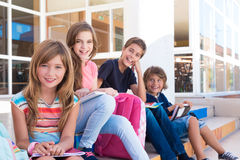 Kids in School. Group of school kids sitting on stairs royalty free stock photos