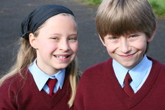Kids in school uniforms Stock Photos