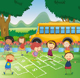 Kids and a schoolbus Stock Image