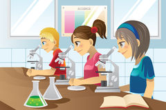 Kids in science lab Stock Images