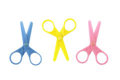 Kids Scissors. Three isolated pairs of small plastic safety  scissors of blue, yellow and pink Stock Photography