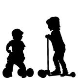 Kids with scooter and tricycle Stock Photo