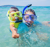 Kids scuba diving Stock Image