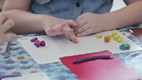 Kids sculpt by plasticine stock footage
