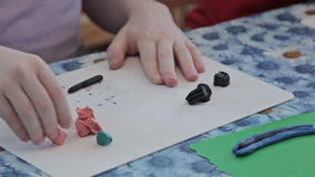 Kids sculpt by plasticine stock video footage