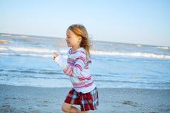 Kids on the sea beach Stock Photos