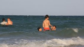 Kids and sea. Tunisian kids bathe in sea stock video footage