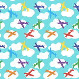 Kids seamless pattern with airplanes, stars and clouds colorful. White background.  Stock Photography
