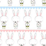 Kids seamless pattern from bunnies. Royalty Free Stock Images