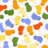 Kids seamless pattern with multi-colored chickens Stock Images