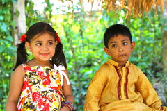 Kids Seated In Forest Stock Photo