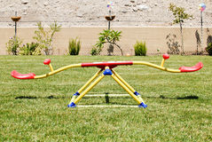Kids See Saw. Kids Colorful Seesaw In Backyard Royalty Free Stock Images