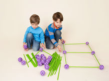 Kids Sharing Construction Set, Building Pieces Royalty Free Stock Image