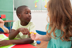 Kids sharing one pencil Royalty Free Stock Photos