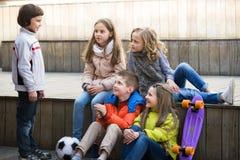 Kids sharing secrets as talking. Cute little boys and girls sharing secrets as talking outdoor royalty free stock photos