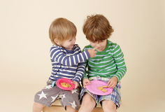 Kids Sharing a Snack, Food, Children's Fashion Stock Photography