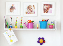 Kids shelf. On white wall with toys on it Royalty Free Stock Image